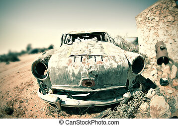 cross processed image of an old car in the desert