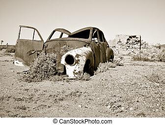 old rusty car in the desert