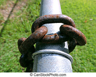 Old Rusty Chain Links on a Metal Fe