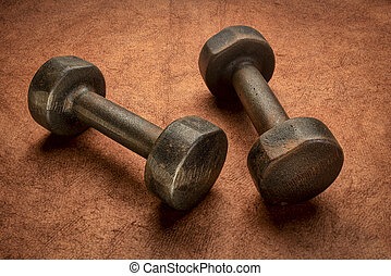 old rusty dumbbells - fitness concept