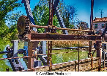 old rusty gears of a regulatory gate