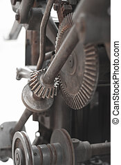 Old rusty gears printing press