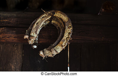 Old rusty horseshoe hanging on the wall