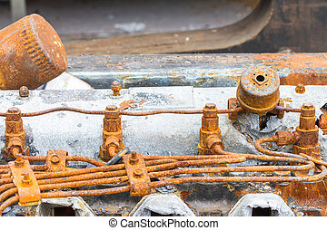 Old rusty injector and fuel pipe of diesel engine