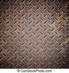 Old rusty iron drain grid.
