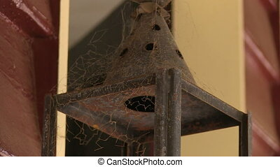 Old rusty lamp of a house - A medium shot of an old rusty...