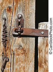 Old rusty latch on barn door.