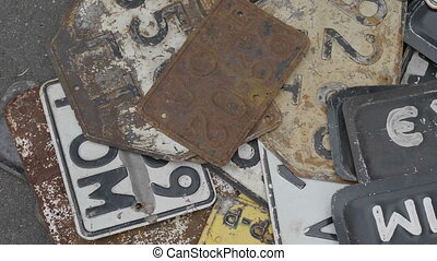 Old rusty license plates of cars. Ultra HD stock footage.