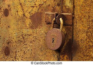Old, rusty lock on a metal door