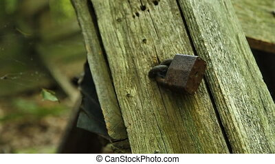Old rusty lock on abandoned house.