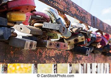 Old rusty lock on the bridge