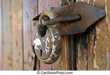 Old rusty lock - The old rusty lock on a wooden door.