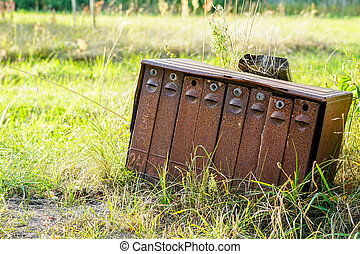 old rusty mailboxes in rural area on a green background