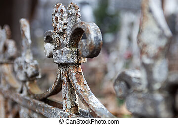 Old rusty metal cemetery fence