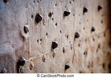 old rusty metal with rivets
