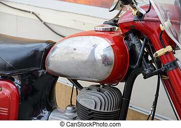 Old rusty motorcycle - a very old and rusty motorcycle in...