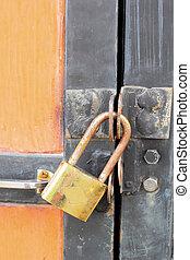 Old rusty padlock on  door closeup