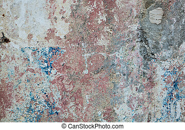 Old rusty painted wall textured background with red, blue and yellow colors.