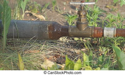 Old rusty pipes and a water tap. Water leakage. Slow motion