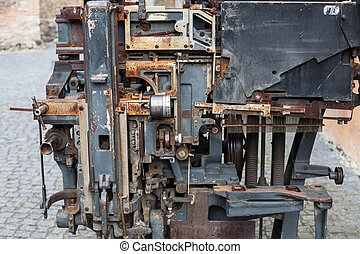 Old rusty printing machine complex mechanism of metal