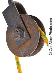 Old rusty pulley with rope