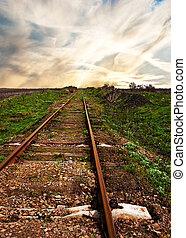 Old rusty rails - the railway leaving afar