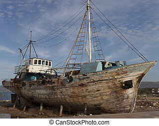 old, rusty ship abandoned on the shore. - old, rusty ship ...