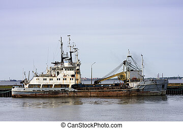 Old rusty ship - Old rusty trade ship at the harbor of ...