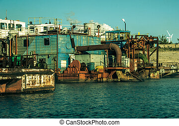 Old rusty ship on river. Sunny day. Shining water surface.