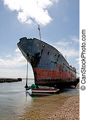 Old rusty ship - View of an old and rusty ship parked at the...