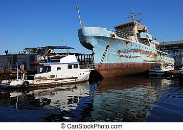 rusty ship - old rusty ship yacht and cutters in the port