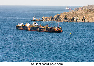 Old Rusty Tanker off Tropical Coast