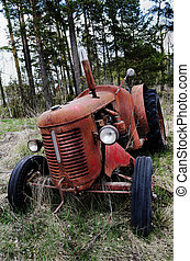 old rusty tractor in the forest
