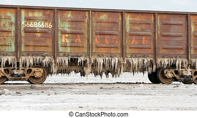 Old rusty train wagons with stalactites of salt