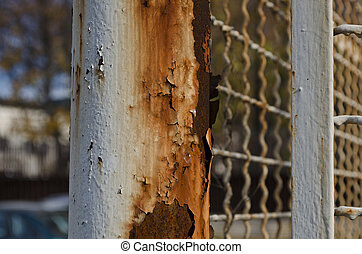Old rusty wire fence with a depth of field