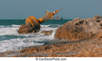 Old Rusty Yellow Buoy Lies on the Shore of a Rocky Beach. Thailand. Pattaya. Asia