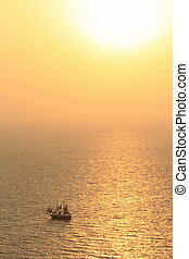 Old sailing boat at sunset