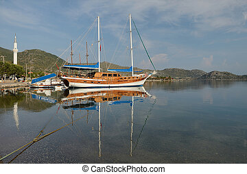 old sailing ship in the sea bay