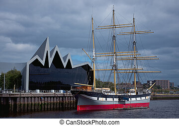 Old sailing ship moored to the pier
