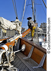 Old sailing ships docked in the old port of Marseille that...