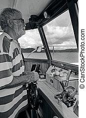 Old sailor navigating his boat