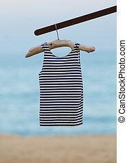 sailor shirt - old sailor shirt hanging on a hanger old