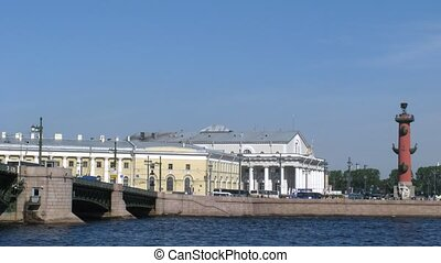 Old Saint Petersburg Stock Exchange and movement of cars on the Palace bridge in St.Petersburg, Russia.