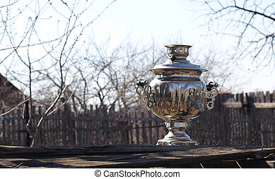 Old samovar on grungy wooden table