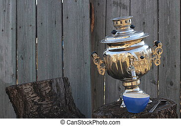 Old samovar on stump and cup