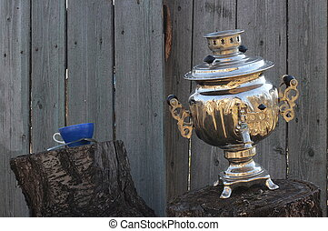 Old samovar on stump and cup