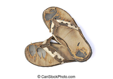 Pair of old used beach sandals on white