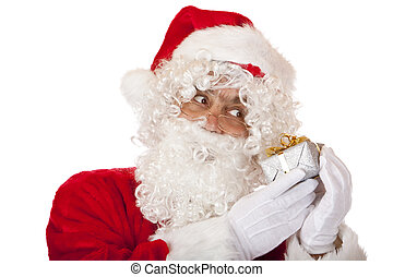 Old Santa Claus is listening a Christmas present.