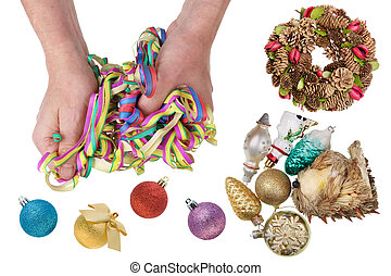 Old Santa Claus with his hands untangles New Year paper garland.