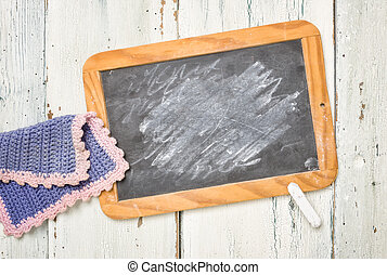 Old school blackboard with chalk and a cleaning cloth